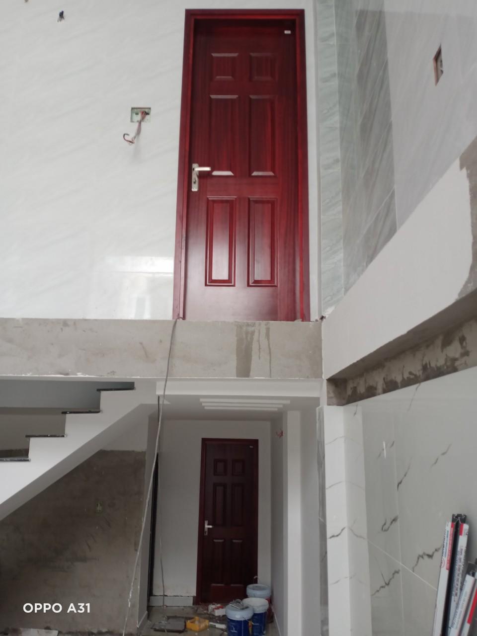 Thi công cửa gỗ công nghiệp HDF Veneer tại 7 bộ HDF Veneer . Địa chỉ : 32/35 Cao Thắng - Quận 3 - Tp.HCm