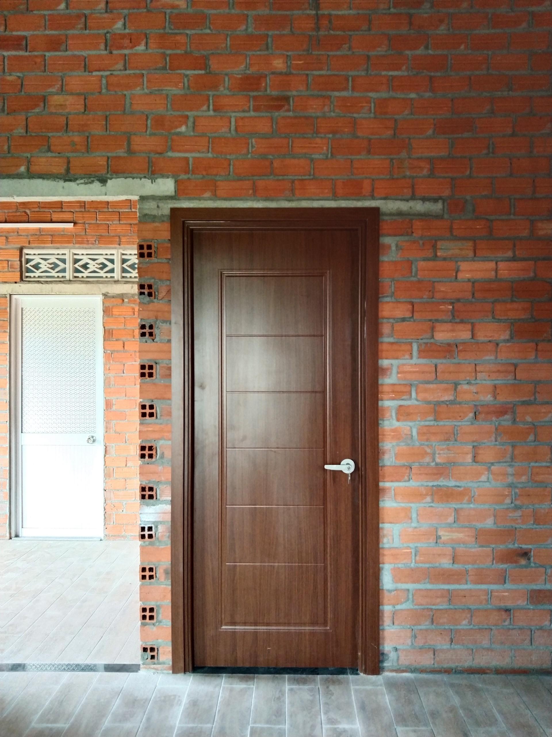 Mẫu cửa nhựa composite phủ da giả gỗ