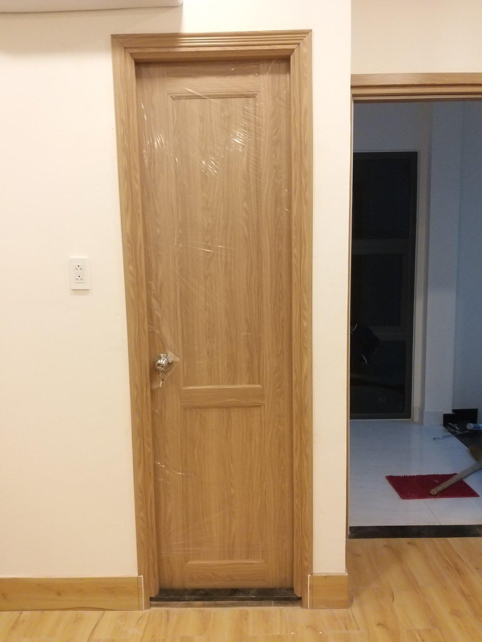 cửa nhựa gải gỗ đài loan cho chung cư